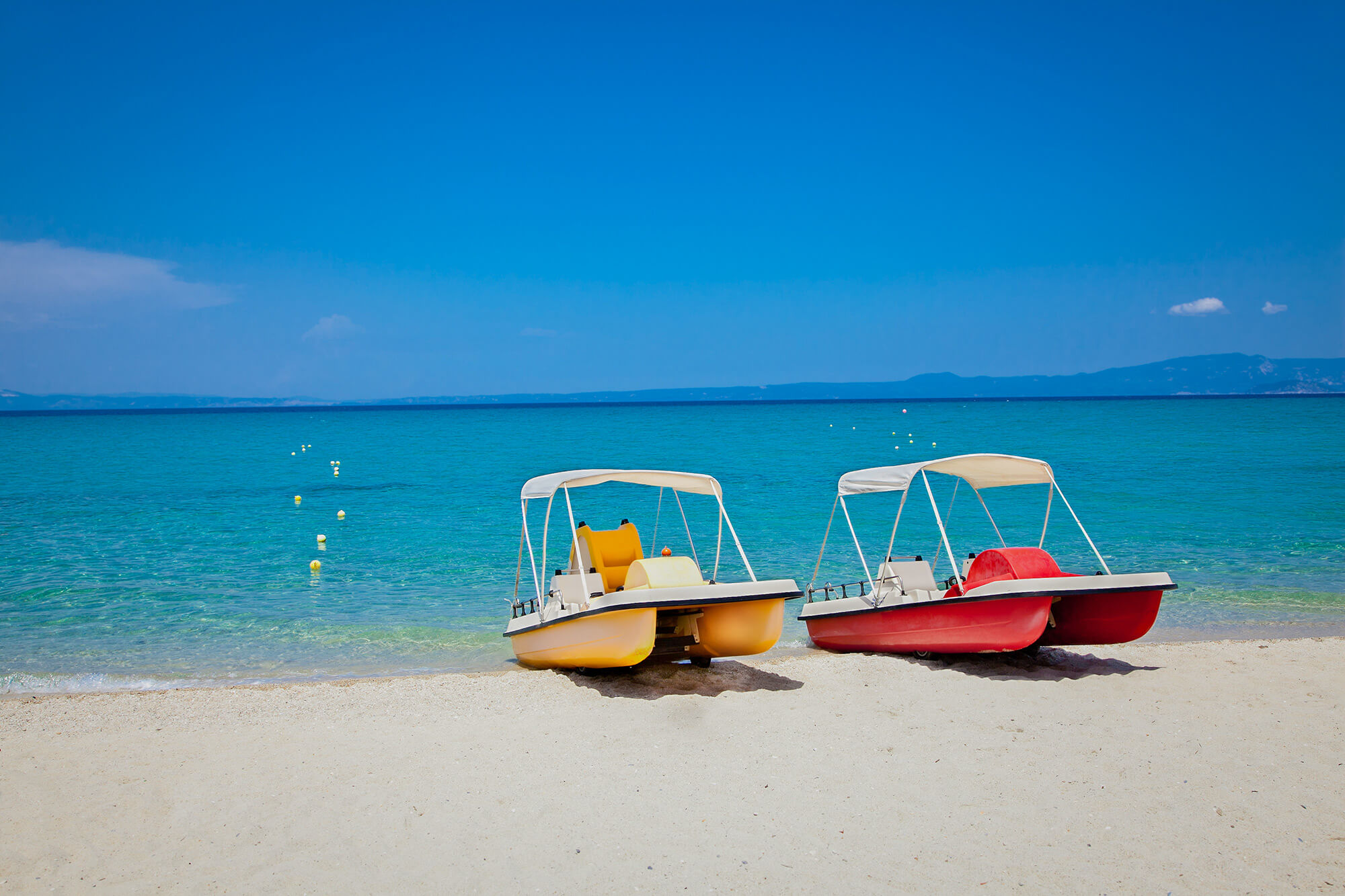 Катамараны на пляже Ханиоти, Халкидики