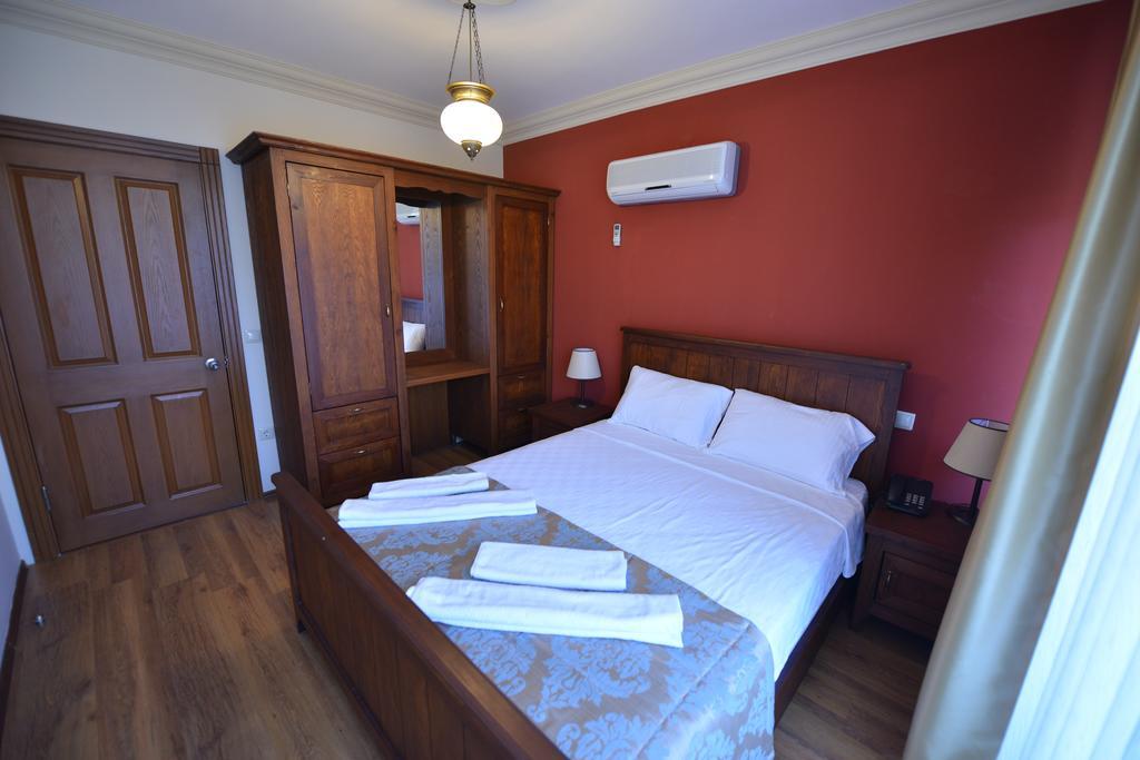 Спальня в апарт-отеле Dores Residence
